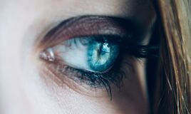 Sad blue eye Royalty Free Stock Photo