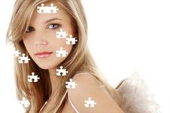 Sad blue-eyed angel puzzle portrait Stock Photos
