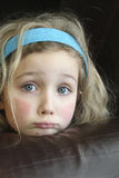 Sad Blue Eyed Little Girl. A cute little girl is feeling a bit blue Royalty Free Stock Image