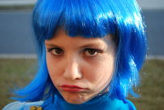 Sad blue-haired girl. Girl with blue hair stock images