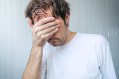 Sad and blue man covering face and crying Royalty Free Stock Photography