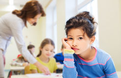 Sad or bored little school girl Stock Image