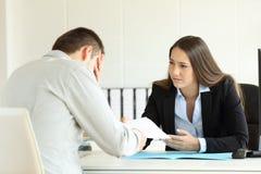 Free Sad Boss Firing An Employee At Office Stock Photos - 97225203