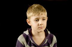 Sad boy. Sad young boy, isolated on black Royalty Free Stock Images