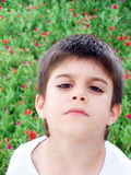 Sad Boy. My son is in our garden Stock Image