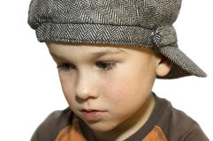 Sad boy. Sad six year old thinking about something. On white background royalty free stock images