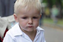 Sad boy. Portrait of sad boy in the summer Stock Images
