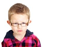 Sad Boy. Boy looking sad shot against a white background. Good to convey emotions, growing up, stress, worry and upset Stock Images