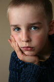 Sad boy. Portraits of sad boy on dark background Stock Image