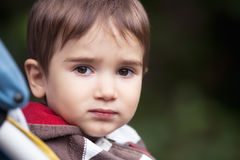 Sad boy. Portrait of a small sad boy royalty free stock photos