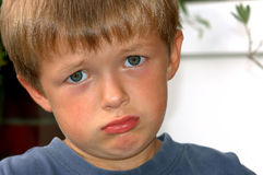 Sad boy. Young boy is looking very sad stock photography