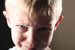 Sad Boy. A sad blond boy with tears streaming down his face Stock Photography