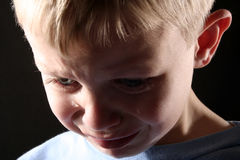 Sad Boy. A sad blond boy with tears streaming down his face Stock Images
