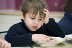 Sad boy. Does not want to eat at the  kindergarten Royalty Free Stock Photos
