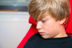 Sad boy. Boy is sad andlooking sideward Royalty Free Stock Photo