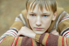 Sad boy in autumn park Royalty Free Stock Images