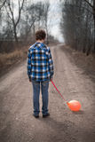 The sad boy with a balloon Royalty Free Stock Images