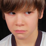 Sad Boy Being Bullied. This boy is sad and troubled.  Is he about to cry?  What is bothering him?  Are other children bullying him Royalty Free Stock Images