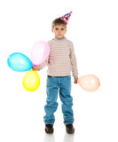 Sad boy in birthday cap. Isolated on white Stock Photos