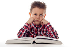 Sad boy with book Royalty Free Stock Images
