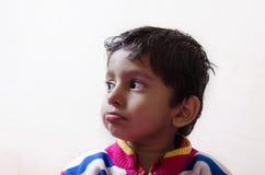 Sad boy child looking sideways closeup Stock Photography