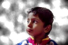 Sad boy child looking sideways closeup Stock Photo