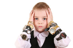 Sad boy with clocks. On white Royalty Free Stock Image