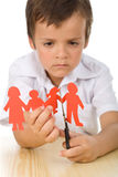 Sad boy cutting paper people family Royalty Free Stock Images