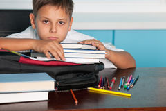 Sad boy at the desk royalty free stock image