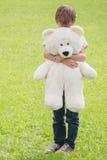 Sad boy embracing his teddy bear Stock Photography