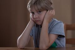Sad boy having family problems Royalty Free Stock Images