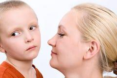Sad boy with his mother on white Stock Photo