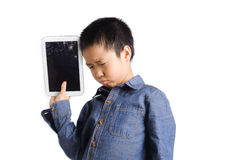 Sad boy hold cracked tablet device. On white background stock images