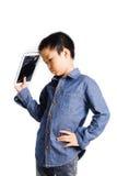 Sad boy hold cracked tablet device. On white background stock photo