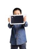 Sad boy hold cracked tablet device. On white background stock photos