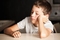 Sad boy. At home. Unhappy child. Emotions stress at teenager Royalty Free Stock Photos