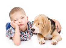 Sad boy hugging beagle puppy. isolated on white background Royalty Free Stock Image