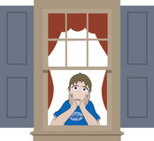 Sad boy leaning in window sill Stock Image
