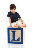 Sad Boy on Letter L Stock Images