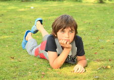 Sad boy. Little boy - sad kid being seriously thinking Stock Images