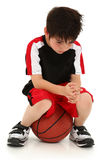 Sad Boy Lost Basketball Game Royalty Free Stock Photography