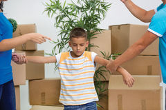 Sad boy while parents quarreling in new home royalty free stock photo
