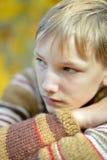 Sad boy in park. Portrait of a  sad boy in autumn park Stock Photo