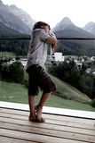 Sad boy pensive in front of mountains Stock Photo