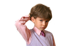 The sad boy in a pink shirt Stock Photo