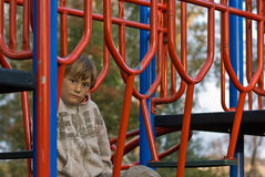 Sad boy in playground Stock Photos