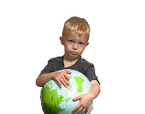 Sad boy points to world. This boy is concerned with our environment on a global level Royalty Free Stock Images