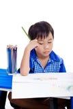 Sad boy sitting bored Stock Image