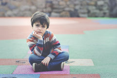 Sad boy. Sitting on the floor Stock Photos