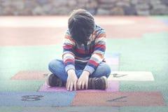 Sad boy. Sitting on the floor Stock Photography